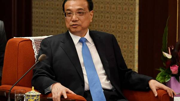 China's premier says economy under increasing pressure amid external volatility