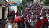 More Honduran migrants seek to join U.S.-bound group in Guatemala