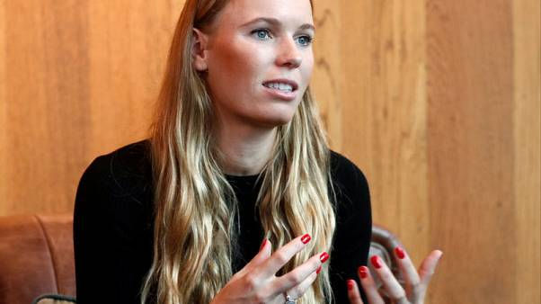 Wozniacki hopes to carry momentum to second WTA Finals win