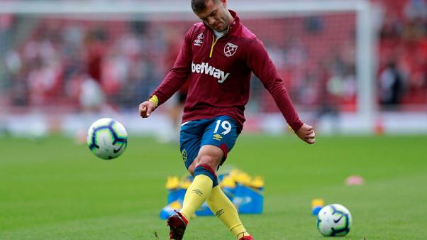 West Ham's Wilshere suffers injury setback, Carroll back in training