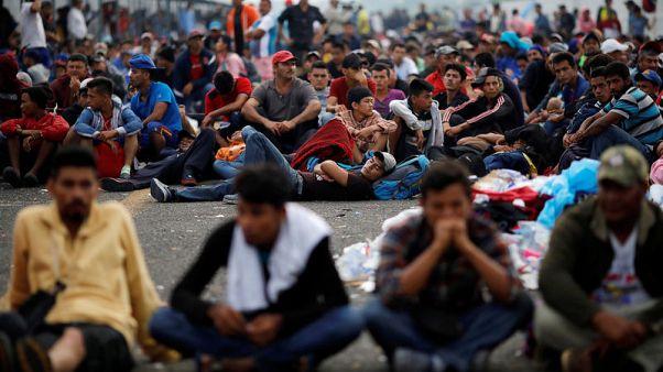 U.S.-bound migrant caravan stuck on Guatemalan border with Mexico