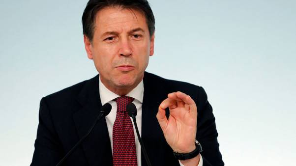 Italy's coalition solves tax row, seeks 'dialogue' with Europe