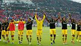 Dortmund crush lowly Stuttgart to stay top