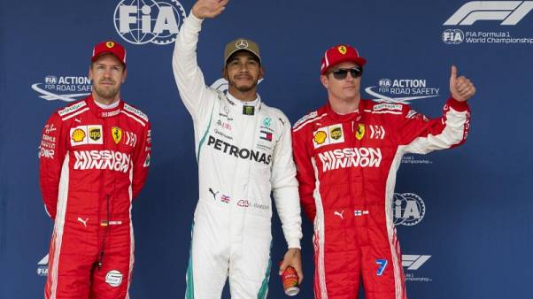 Motor racing - Hamilton on pole in Austin, Vettel starts fifth