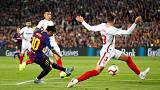 Messi injury blow as Barca go top with win over Sevilla