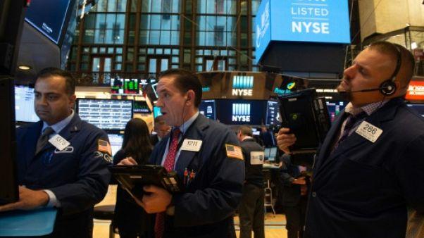 Des courtiers à l'ouverture de la Bourse du New York, le 28 septembre 2018
