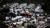 Greece suspends police officer for swearing at a migrant woman