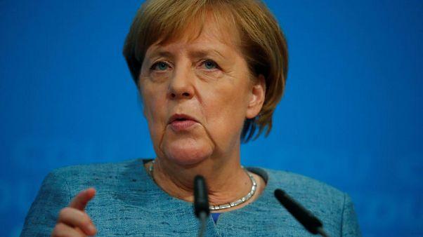Germany's Merkel promises legislation to ward off diesel driving bans