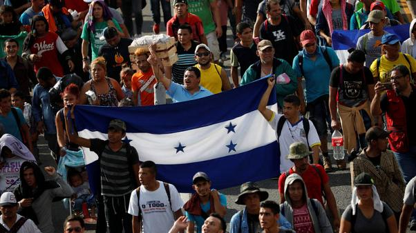 Thousands in U.S.-bound migrant caravan pour into Mexican city