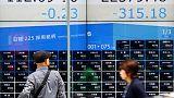 Asia shares slip amid anxiety on earnings, politics