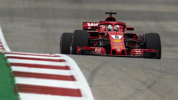 Vettel clings on mathematically for another week