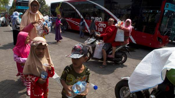 Plastic to ride - Indonesians swap bottles for bus tickets