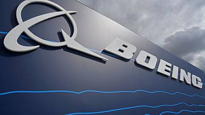 Boeing tops profit estimates, takes further tanker charge
