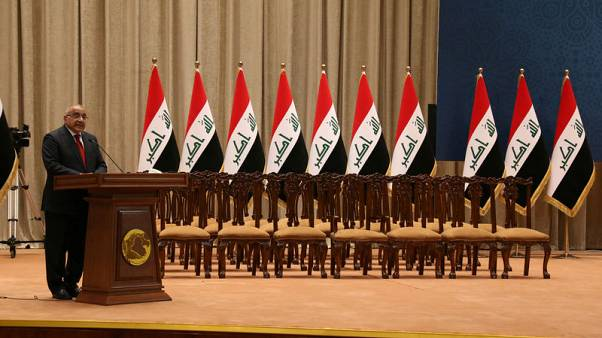Iraq PM sworn with partial cabinet as lawmakers disagree