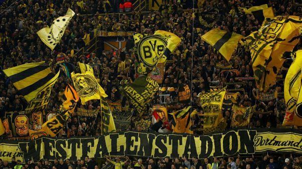 Sparkling Dortmund crush Atletico 4-0 to top Group A