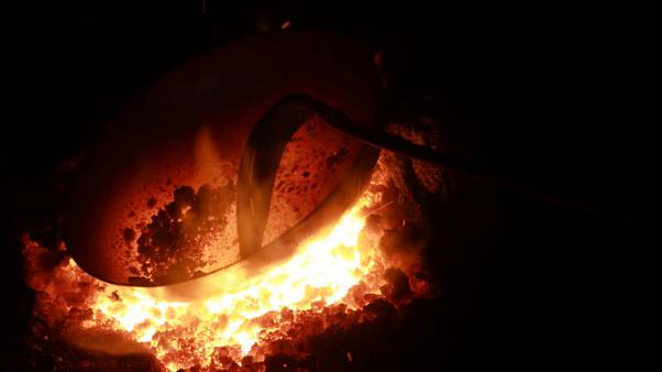 Hammer and tongs - China entrepreneur leads handmade wok revival
