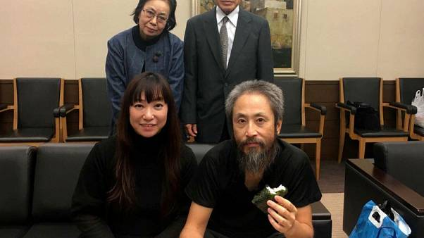Rice balls for Japan hostage as he returns home from Syrian 'hell'