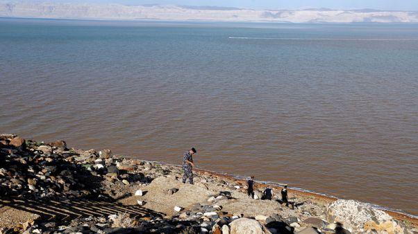 Search for survivors after Jordan floods kill 20 people, many schoolchildren