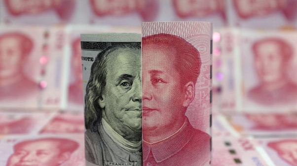 Exclusive: Guarding stability, China likely to slow yuan's slide to 7 per dollar: sources