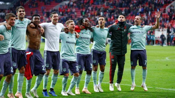 Bayern edge Mainz 2-1, close gap to leaders Dortmund
