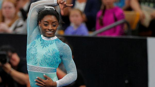 Gymnastics - Biles leads world championships qualifying despite kidney stone