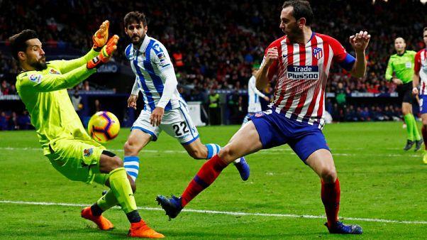 Atletico put Dortmund drubbing aside and go top of La Liga