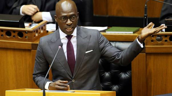 South African home affairs minister says he was blackmailed over sex video