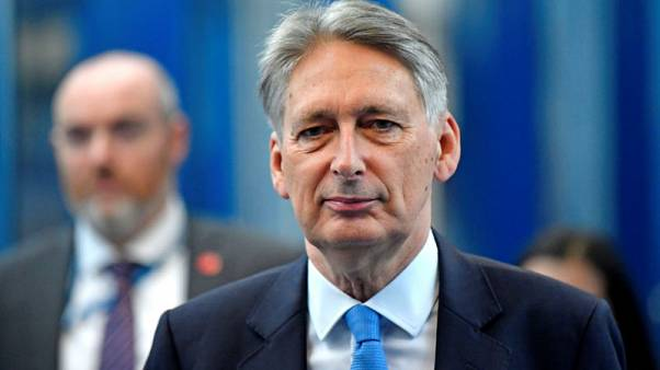 Hammond says has money buffer in case of Brexit shock