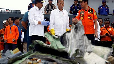 """Indonesia deploys divers, """"pinger locators"""" in hunt for doomed plane's cockpit recorders"""