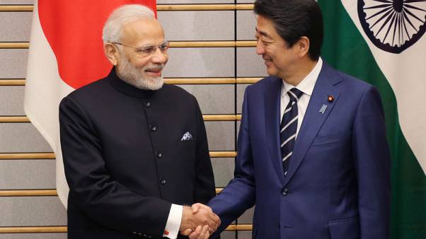 India's Modi and Japan's Abe draw closer as Tokyo woos Beijing