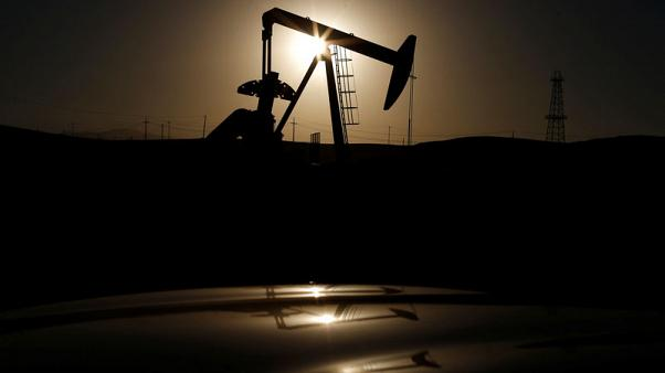 Oil prices fall on rising supply, global market woes