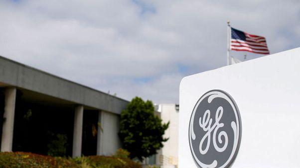 General Electric reveals deeper regulatory probe, restructuring