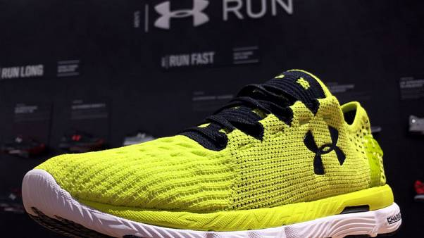 Under Armour margins rise on better pricing, results beat estimates