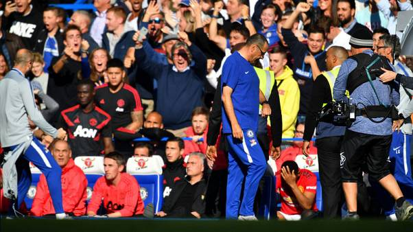 Chelsea coach fined by FA over Mourinho touchline row