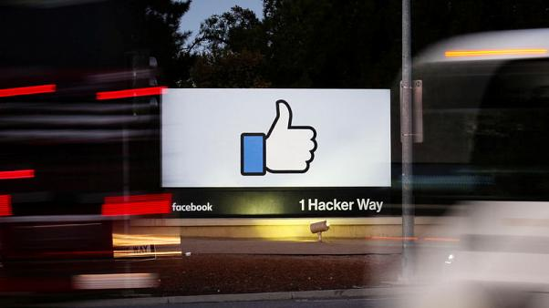 Facebook shares stung by slow user, sales growth