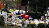 Pittsburgh buries three more shooting victims as suspect faces new charges