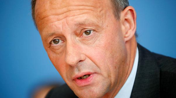 Merz promises to take Merkel's party right in Germany