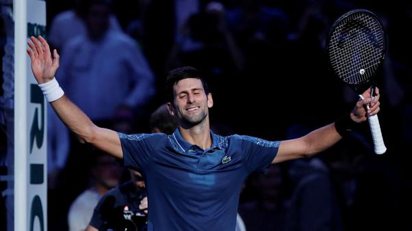Djokovic back on top after Nadal withdraws in Paris