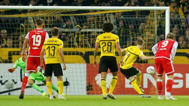 Last-gasp Reus penalty sends Dortmund into German Cup third round