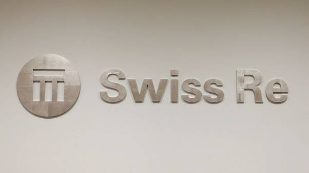 Swiss Re swings to profit in first nine months despite large claims