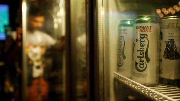 Carlsberg third-quarter sales beat forecast, confirms lifted 2018 outlook