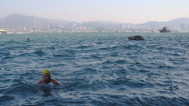Taking the plunge: Hardy Hong Kong swimmers brave busy harbour