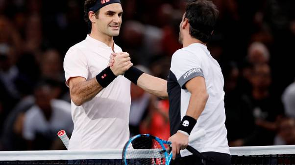 Federer begins road to 100 with a win in Paris