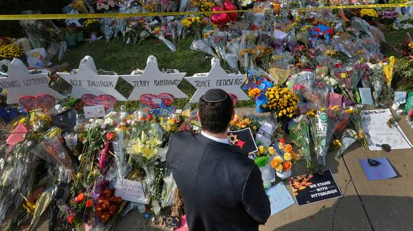 Amid Pittsburgh funerals, synagogue suspect pleads not guilty