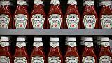 Kraft Heinz quarterly income falls by a third, shares slide