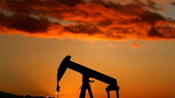 Oil under pressure from rising output, but Iran sanctions loom