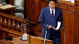 Japan PM Abe says won't insist on sales tax hike if shock hits economy