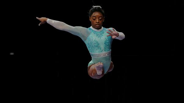 Gymnastics - Biles makes history with fourth all-around world title