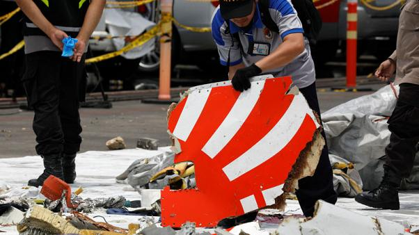 Indonesia struggles with damaged black box from crashed jet, hunts for second