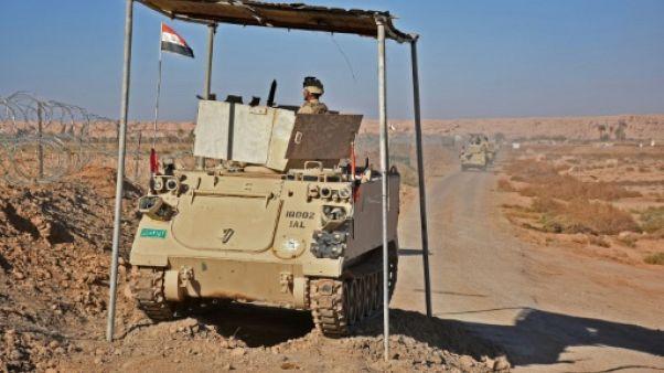 Après un revers des anti-EI en Syrie, l'Irak redéploie des forces à la frontière